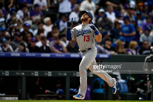 Max Muncy of the Los Angeles Dodgers celebrates as he runs the bases after hitting a fourth inning solo homer against the Colorado Rockies during the...
