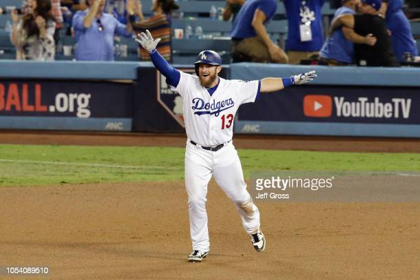 Max Muncy of the Los Angeles Dodgers celebrates his eighteenth inning walkoff home run to defeat the the Boston Red Sox 32 in Game Three of the 2018...