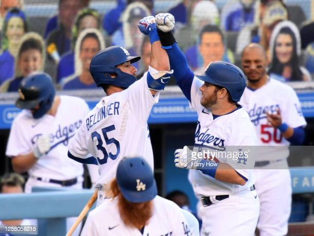 Max Muncy of the Los Angeles Dodgers celebrates his solo homerun with Cody Bellinger, to take a 1-0 lead over the San Francisco Giants, during the...