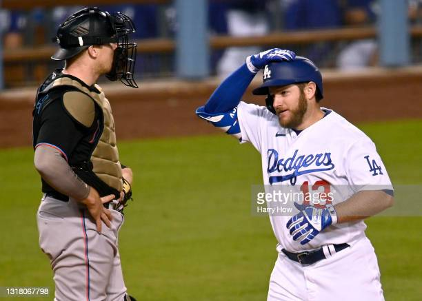 Max Muncy of the Los Angeles Dodgers celebrates his three run homerun past Chad Wallach of the Miami Marlins, to take an 8-0 lead, during the second...