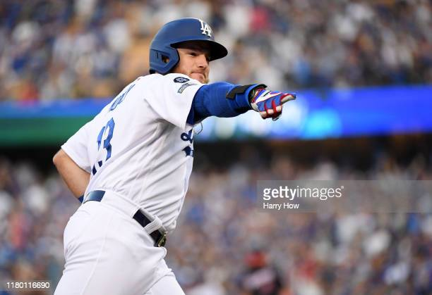 Max Muncy of the Los Angeles Dodgers celebrates his two run home run in the first inning of game five of the National League Division Series against...