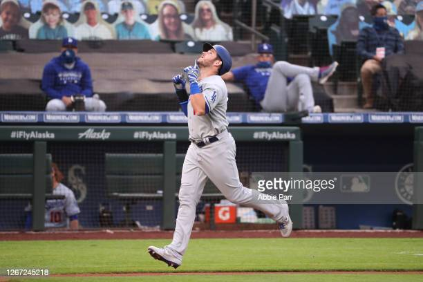 Max Muncy of the Los Angeles Dodgers celebrates while lapping the bases after hitting a solo home run against the Seattle Mariners in the second...