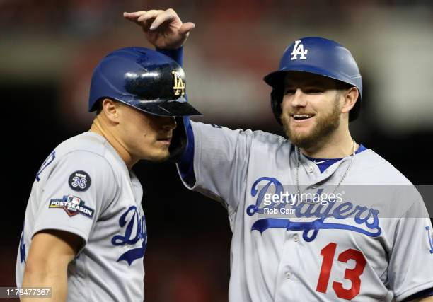 Max Muncy of the Los Angeles Dodgers celebrates with Kike Hernandez after they scored on a home run by Justin Turner during the sixth inning of Game...