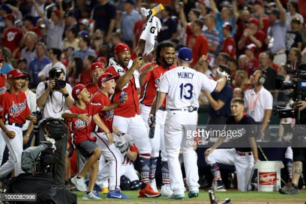 Max Muncy of the Los Angeles Dodgers celebrates with Matt Kemp of the Los Angeles Dodgers and the National League after winning his first round...