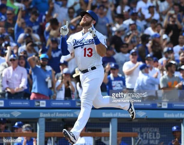 Max Muncy of the Los Angeles Dodgers crosses the plate after hitting a two run home run in the sixth inning of the game against the Colorado Rockies...