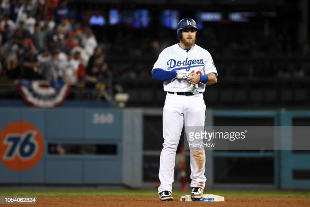 Max Muncy of the Los Angeles Dodgers doubles during the tenth inning against the Boston Red Sox in Game Three of the 2018 World Series at Dodger...