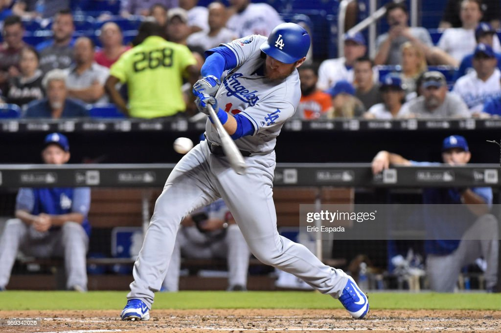Max Muncy #13 of the Los Angeles Dodgers doubles in the sixth inning against the Miami Marlins at Marlins Park on May 16, 2018 in Miami, Florida.