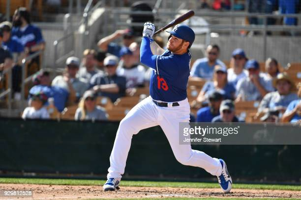 Max Muncy of the Los Angeles Dodgers flies out to center in the spring training game against the Cleveland Indians at Camelback Ranch on March 1 2018...