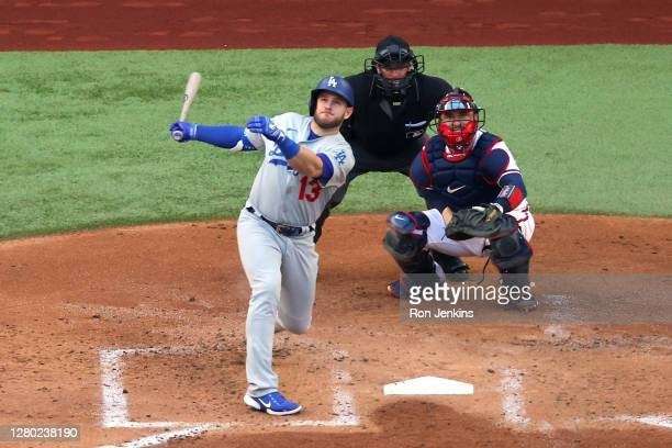 Max Muncy of the Los Angeles Dodgers hits a grand slam home run against the Atlanta Braves during the first inning in Game Three of the National...