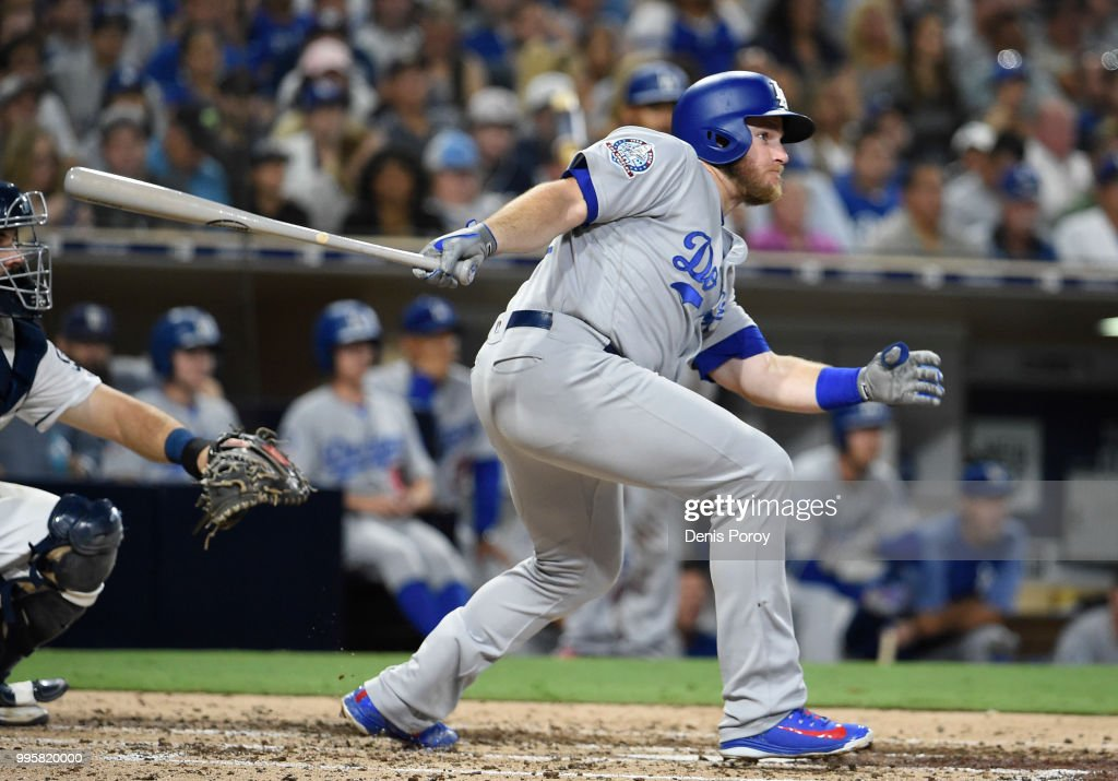 Max Muncy #13 of the Los Angeles Dodgers hits a single during the seventh inning of a baseball game against the San Diego Padres at PETCO Park on July 10, 2018 in San Diego, California.