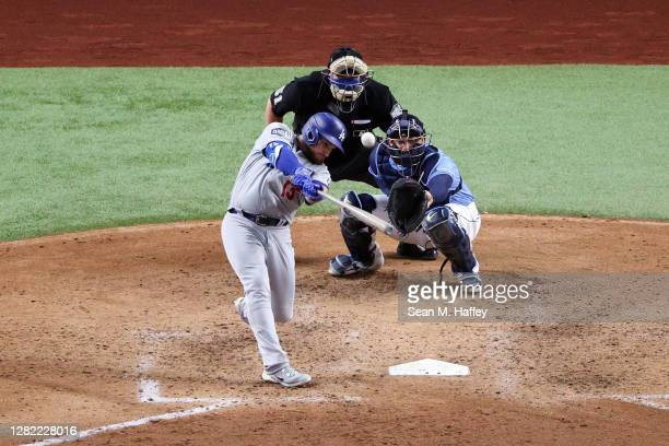 Max Muncy of the Los Angeles Dodgers hits a solo home run against the Tampa Bay Rays during the fifth inning in Game Five of theing 2020 MLB World...