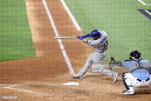 Max Muncy of the Los Angeles Dodgers hits a solo home run against the Tampa Bay Rays during the fifth inning in Game Five of the 2020 MLB World...