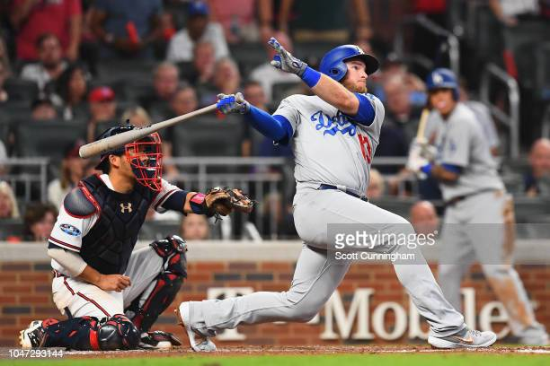 Max Muncy of the Los Angeles Dodgers hits a solo home run in the fifth inning against the Atlanta Braves during Game Three of the National League...