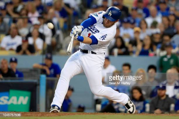 Max Muncy of the Los Angeles Dodgers hits a three run home run during the second inning against the Atlanta Braves during Game One of the National...