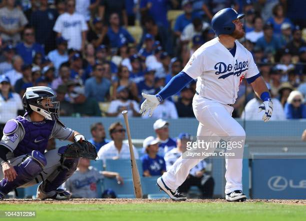 Max Muncy of the Los Angeles Dodgers hits a two run home run in the fifth inning of the game against the Colorado Rockies at Dodger Stadium on...
