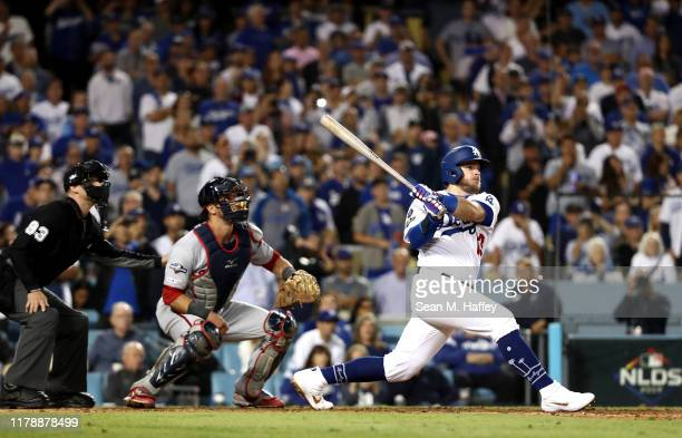 Max Muncy of the Los Angeles Dodgers hits a two run RBI single in the seventh inning of game one of the National League Division Series against the...