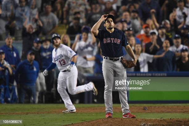 Max Muncy of the Los Angeles Dodgers hits an eighteenth inning walk-off home run on a pitch from Nathan Eovaldi of the Boston Red Sox in Game Three...