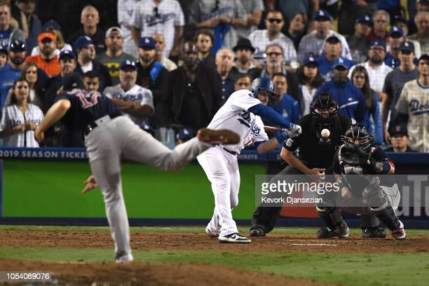 Max Muncy of the Los Angeles Dodgers hits an eighteenth inning walkoff home run on a pitch from Nathan Eovaldi of the Boston Red Sox in Game Three of...