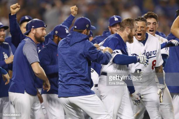 Max Muncy of the Los Angeles Dodgers is congratulated by his teammates after his eighteenth inning walkoff home run to defeat the the Boston Red Sox...