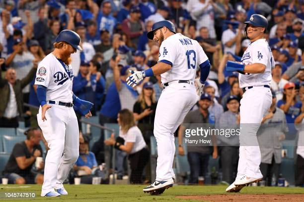 Max Muncy of the Los Angeles Dodgers is congratulated by his teammates Justin Turner and Joc Pederson after his second inning 3 RBI home run against...
