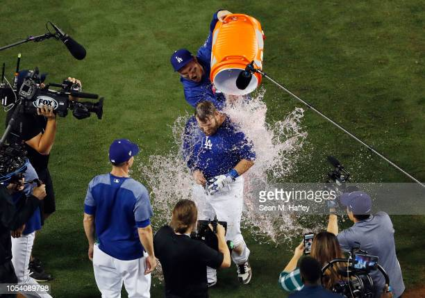 Max Muncy of the Los Angeles Dodgers is given a gatorade bath after hitting his eighteenth inning walkoff home run to defeat the Boston Red Sox 32 in...