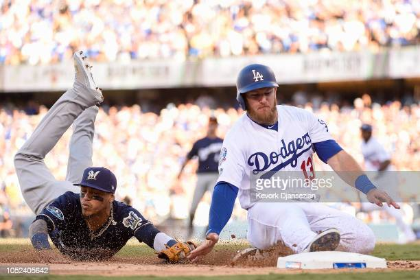 Max Muncy of the Los Angeles Dodgers is tagged out at third base by Orlando Arcia of the Milwaukee Brewers during the sixth inning in Game Five of...