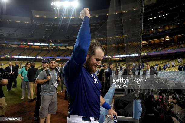 Max Muncy of the Los Angeles Dodgers leaves the field after celebrating his eighteenth inning walkoff home run to defeat the the Boston Red Sox 32 in...