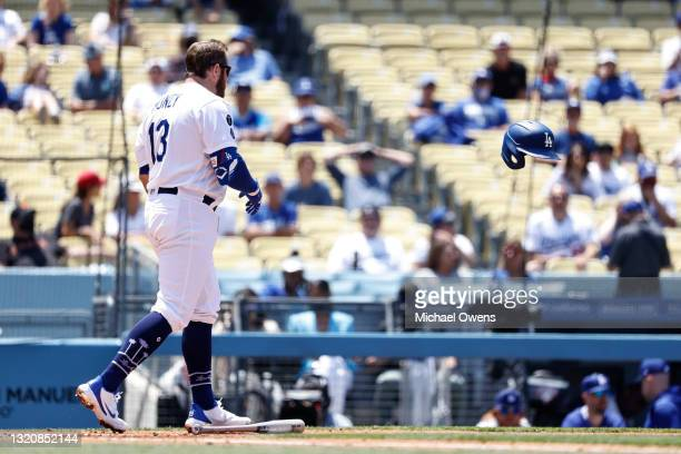 Max Muncy of the Los Angeles Dodgers reacts after striking out against the San Francisco Giants during the third inning at Dodger Stadium on May 30,...