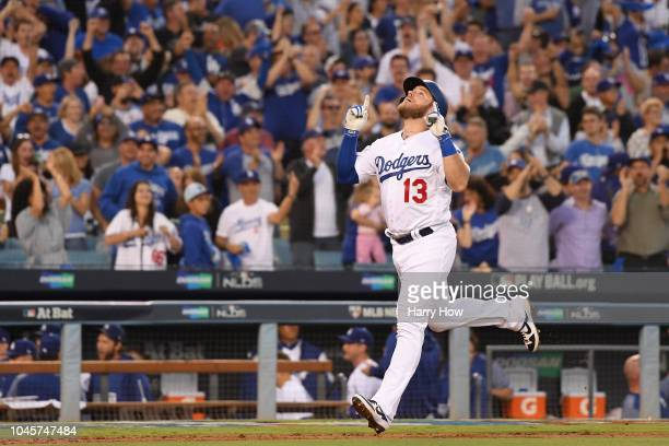 Max Muncy of the Los Angeles Dodgers reacts to his second inning 3 RBI home run against the Atlanta Braves during Game One of the National League...