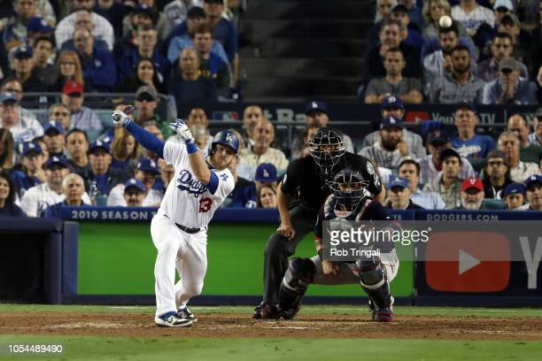 Max Muncy of the Los Angeles Dodgers singles in the seventh inning during Game 4 of the 2018 World Series against the Boston Red Sox at Dodger...