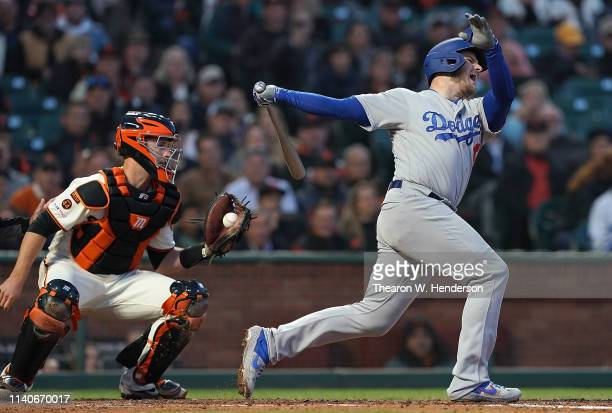 Max Muncy of the Los Angeles Dodgers strikes out swinging with the bases loaded against the San Francisco Giants to end the top of the fourth inning...