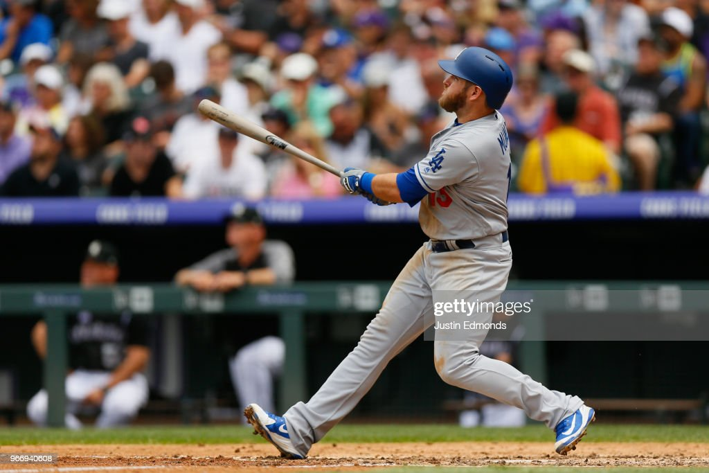 Max Muncy #13 of the Los Angeles Dodgers watches his three run home run during the third inning against the Colorado Rockies at Coors Field on June 3, 2018 in Denver, Colorado.
