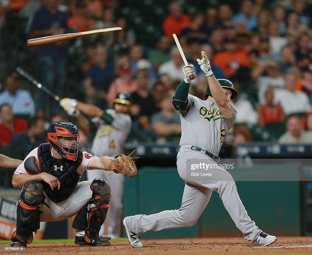 Max Muncy #12 of the Oakland Athletics shatters his bat as he hits into a double play in the third inning against the Houston Astros at Minute Maid Park on August 29, 2016 in Houston, Texas.
