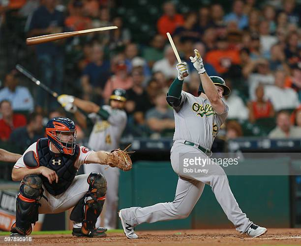 Max Muncy of the Oakland Athletics shatters his bat as he hits into a double play in the third inning against the Houston Astros at Minute Maid Park...