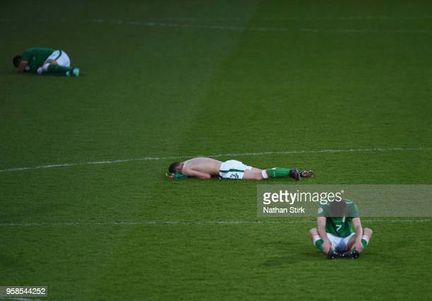 Max Murphy of Ireland and his team mates react after losing on penalties against the Netherlands during the UEFA European Under17 Championship match...