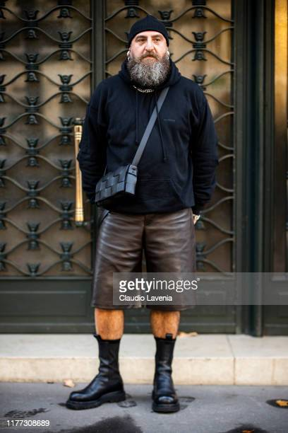 Max Napolitano wearing black sweatshirt brown leather shorts black boots and Bottega Veneta bag is seen outside the Faith Connexion show during Paris...