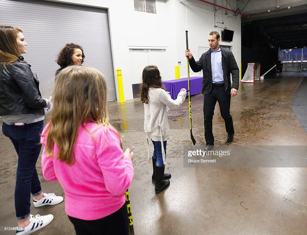 Max Nicastro #2 of Orlando Solar Bears gives a fan a stick following a game at the Amway Center on February 13, 2016 in Orlando, Florida.