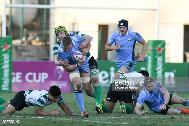 Max NorthcoteGreen of London Irish is tackled during the European Rugby Challenge Cup match between Krasny Yar and London Irish at Avchala Stadium on...