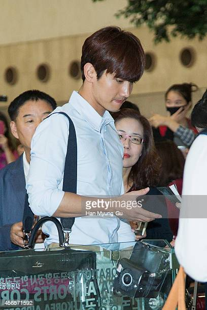 Max of South Korean boy band TVXQ is seen on departure at Gimpo International Airport on October 3 2014 in Seoul South Korea