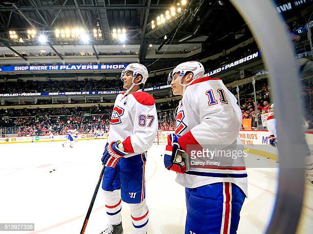 Max Pacioretty and Brendan Gallagher of the Montreal Canadiens take part in the pregame warm up prior to NHL action against the Winnipeg Jets at the...