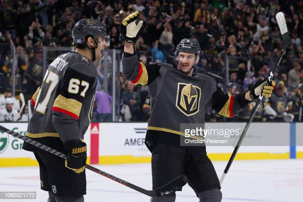 Max Pacioretty and Colin Miller of the Vegas Golden Knights celebrate after Pacioretty scored a goal against the San Jose Sharks during the first...