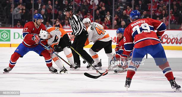 Max Pacioretty and David Desharnais of the Montreal Canadiens battle for the puck against Ray Emery of the Philadelphia Flyers in the NHL game at the...