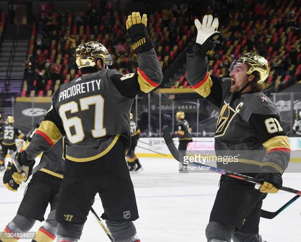 Max Pacioretty and Mark Stone of the Vegas Golden Knights celebrate after Stone assisted Pacioretty on an overtime goal against the Minnesota Wild to...