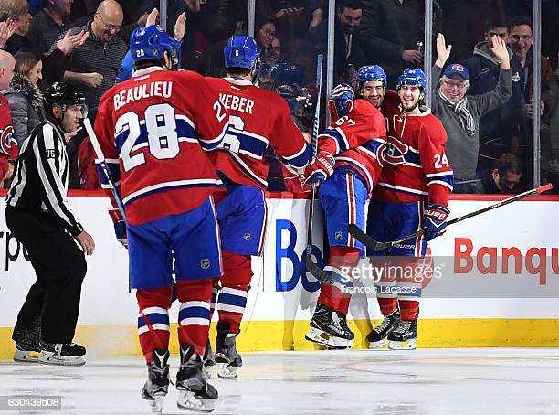 Max Pacioretty and Phillip Danault of the Montreal Canadiens celebrate after scoring a goal the Minnesota Wild in the NHL game at the Bell Centre on...