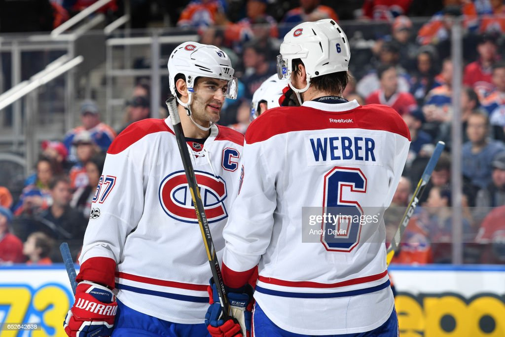 Max Pacioretty #67 and Shea Weber #6 of the Montreal Canadiens discuss the play during the game against the Edmonton Oilers on March 12, 2017 at Rogers Place in Edmonton, Alberta, Canada.