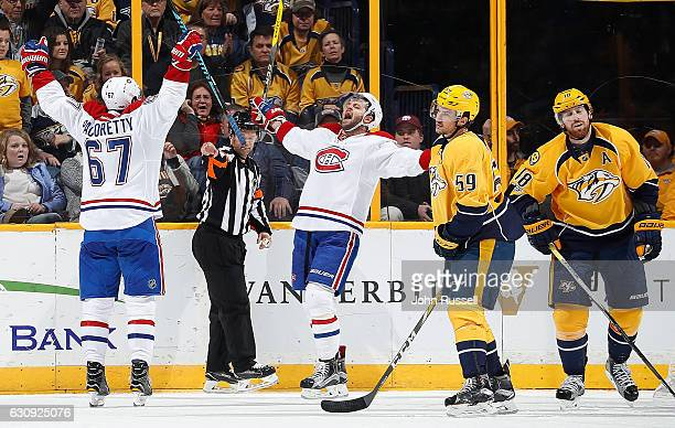 Max Pacioretty celebrates an overtime win with Alexander Radulov of the Montreal Canadiens against Roman Josi and James Neal of the Nashville...