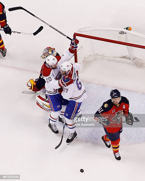 Max Pacioretty celebrates his first period goal with Thomas Vanek of the Montreal Canadiens against the Florida Panthers at the BBT Center on March...