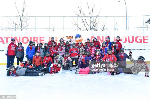 Max Pacioretty Daniel Carr Jonathan Drouin and Nicolas Deslauriers of the Montreal Canadiens pose with members of the Montreal Canadiens and a group...