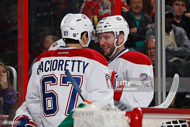 Max Pacioretty is congratulated by Thomas Vanek of the Montreal Canadiens after he scored a second period goal against the Florida Panthers at the...
