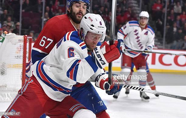 Max Pacioretty of the Montreal Canadiens and Anton Stralman of the New York Rangers battle for position in Game Five of the Eastern Conference Final...